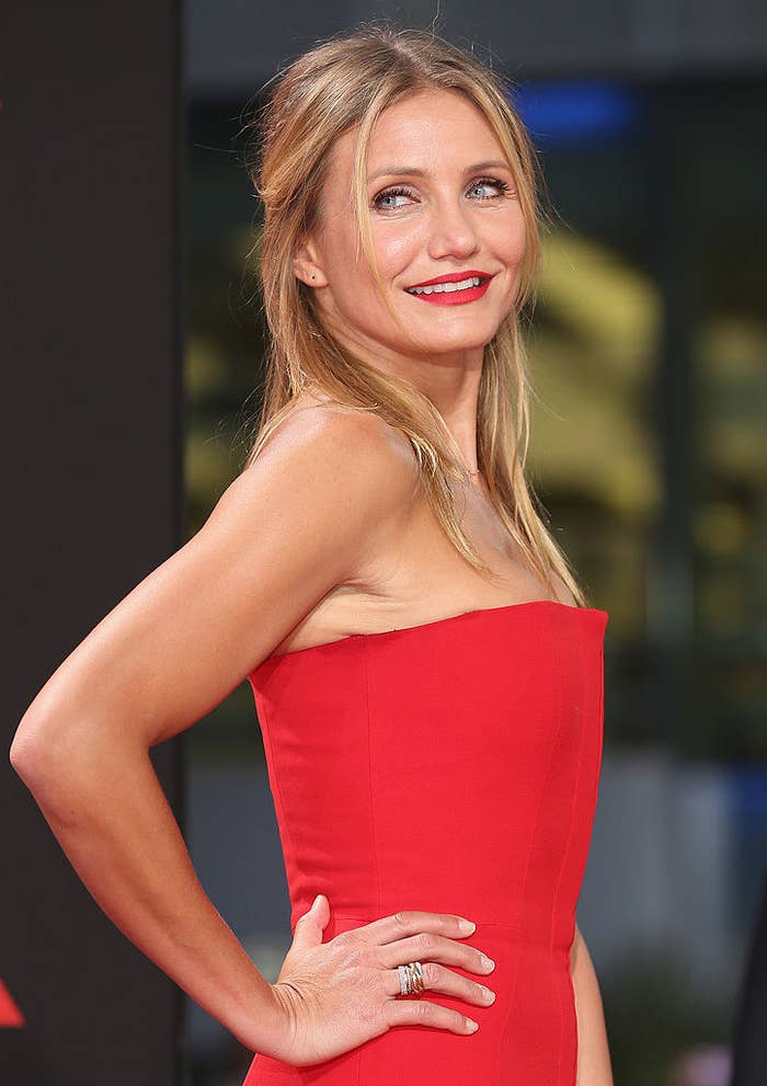 Cameron Diaz arrives for the German premiere of the film 'Sex Tape' in a brightly-colored strapless dress with matching lipstick