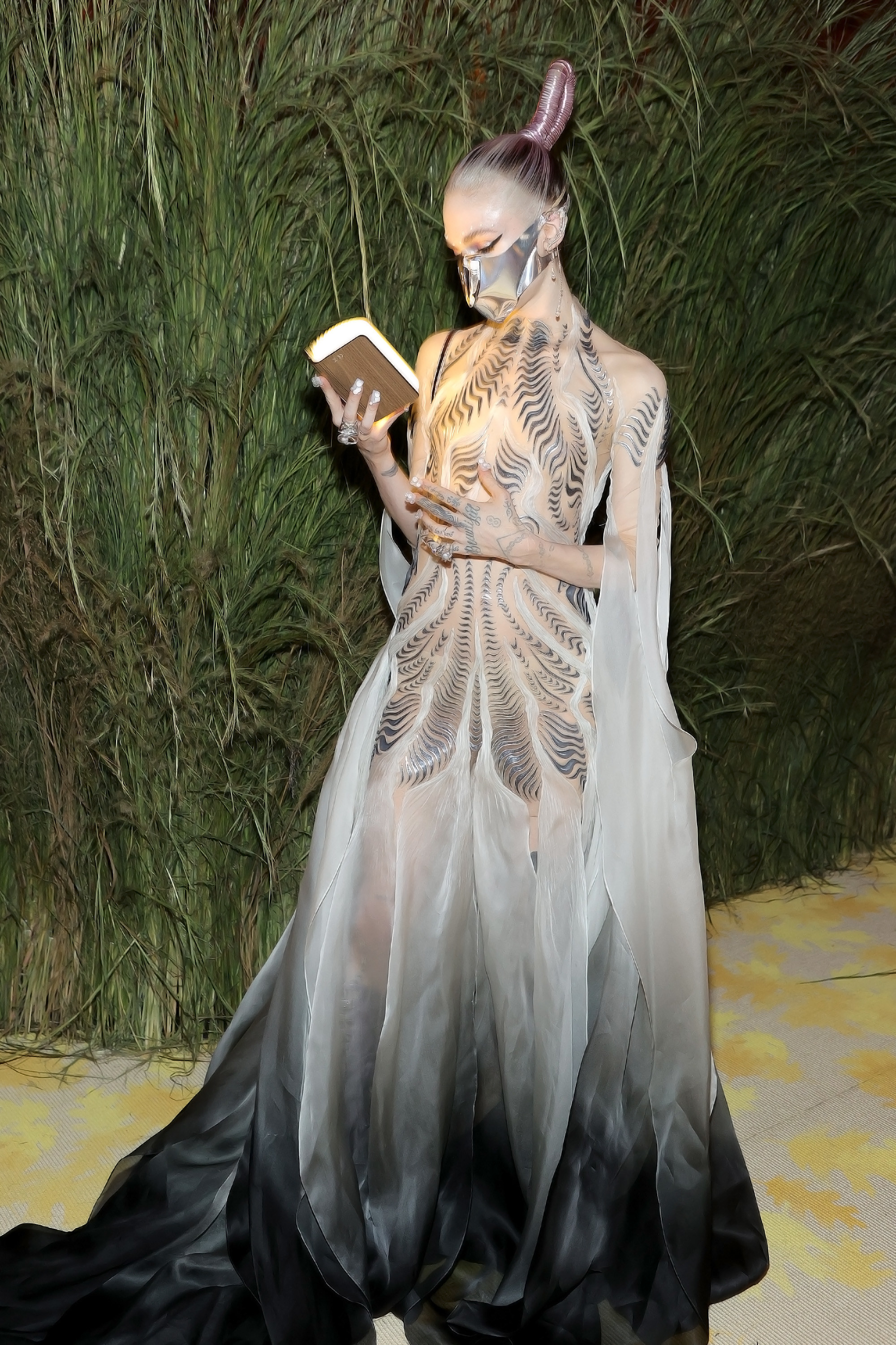 Grimes reads from the book, which is glowing with light