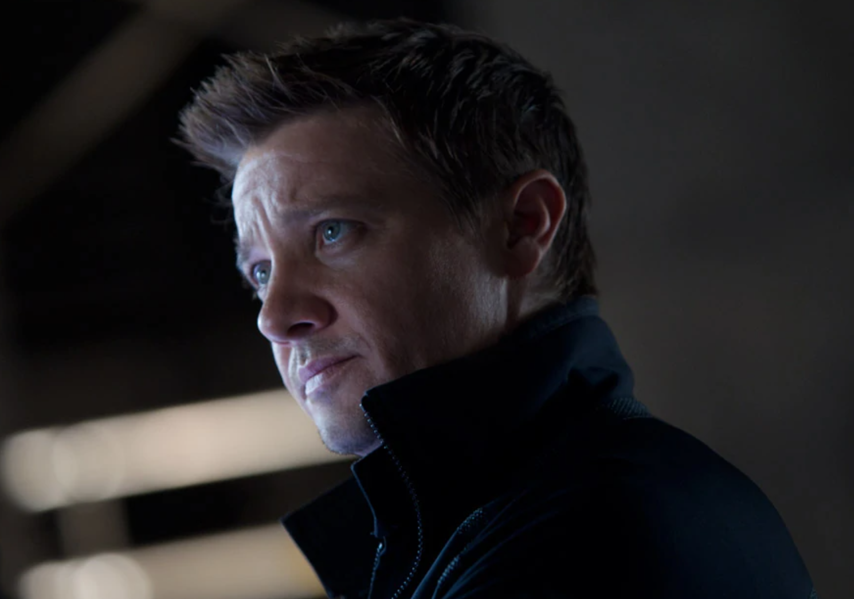 A close up of Hawkeye as he looks up at someone off screen