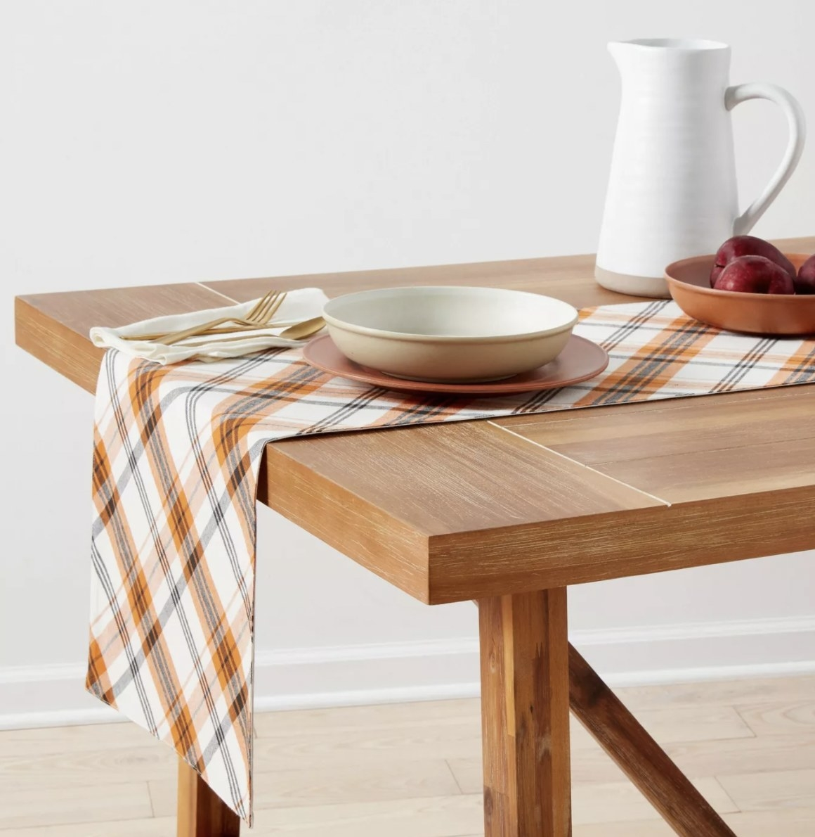 an orang and black plaid table runner