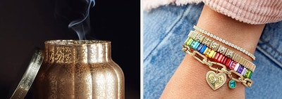 to the left: a gold candle, to the right: an arm stacked with bracelets