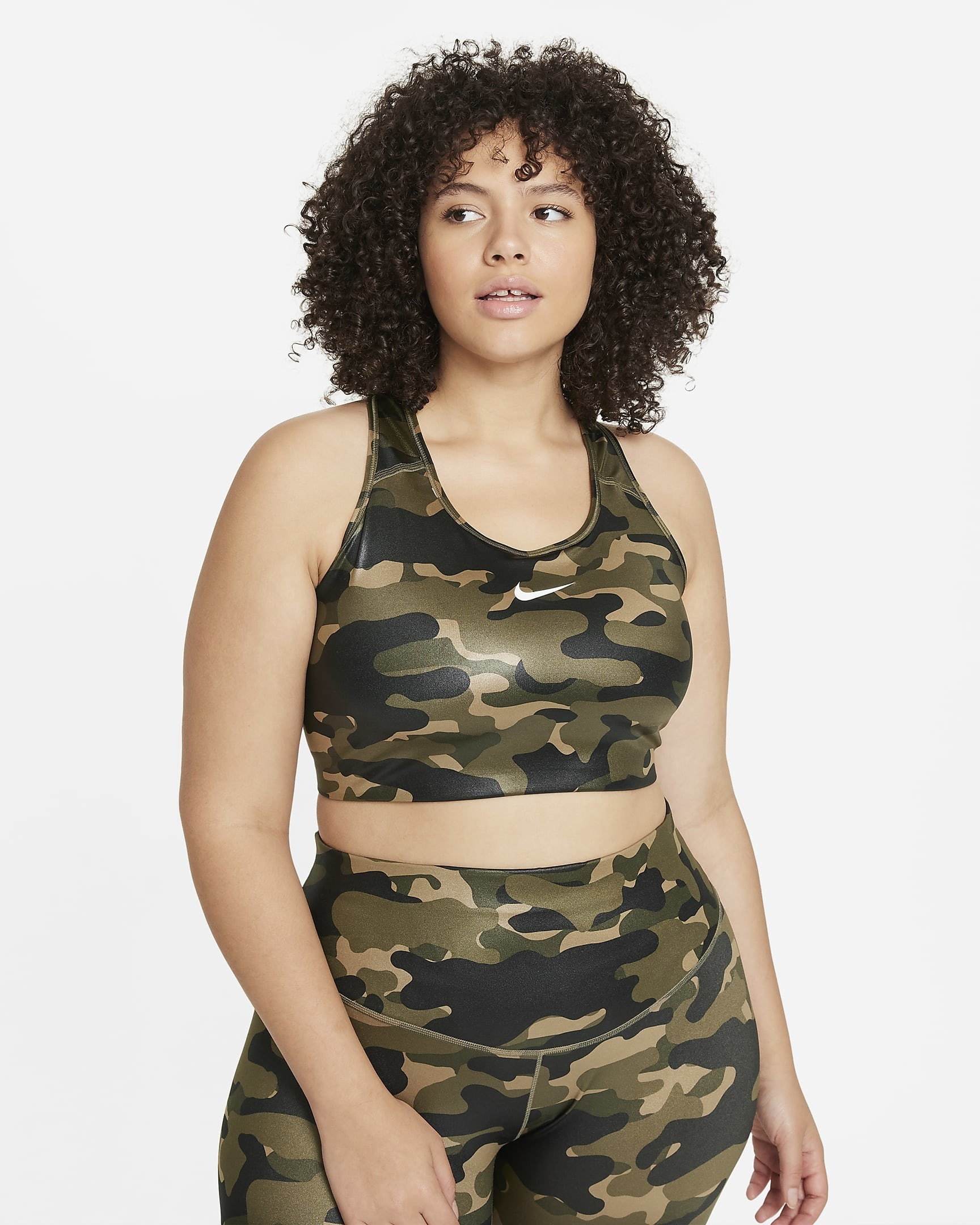 Model wearing green camouflage sports bra with matching leggings
