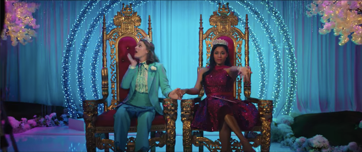 Emma and Alyssa sitting on prom thrones