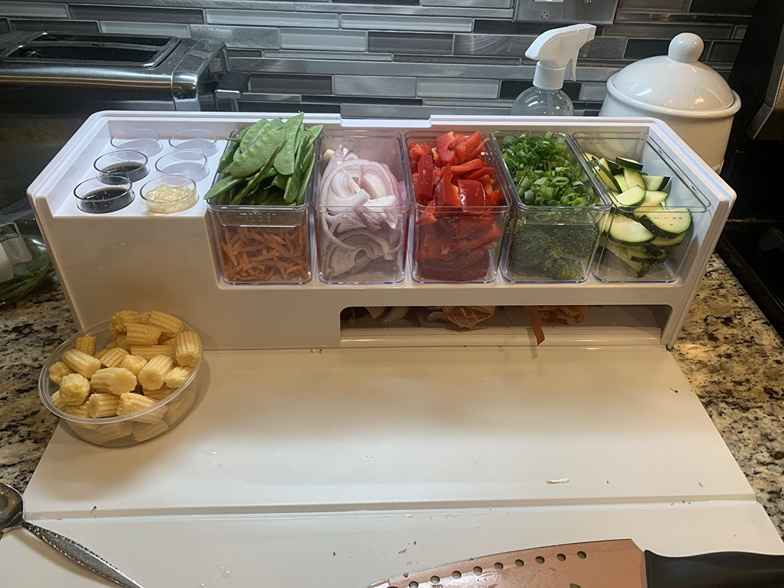 Reviewer photo of the white meal prep station with various vegetables in each compartment