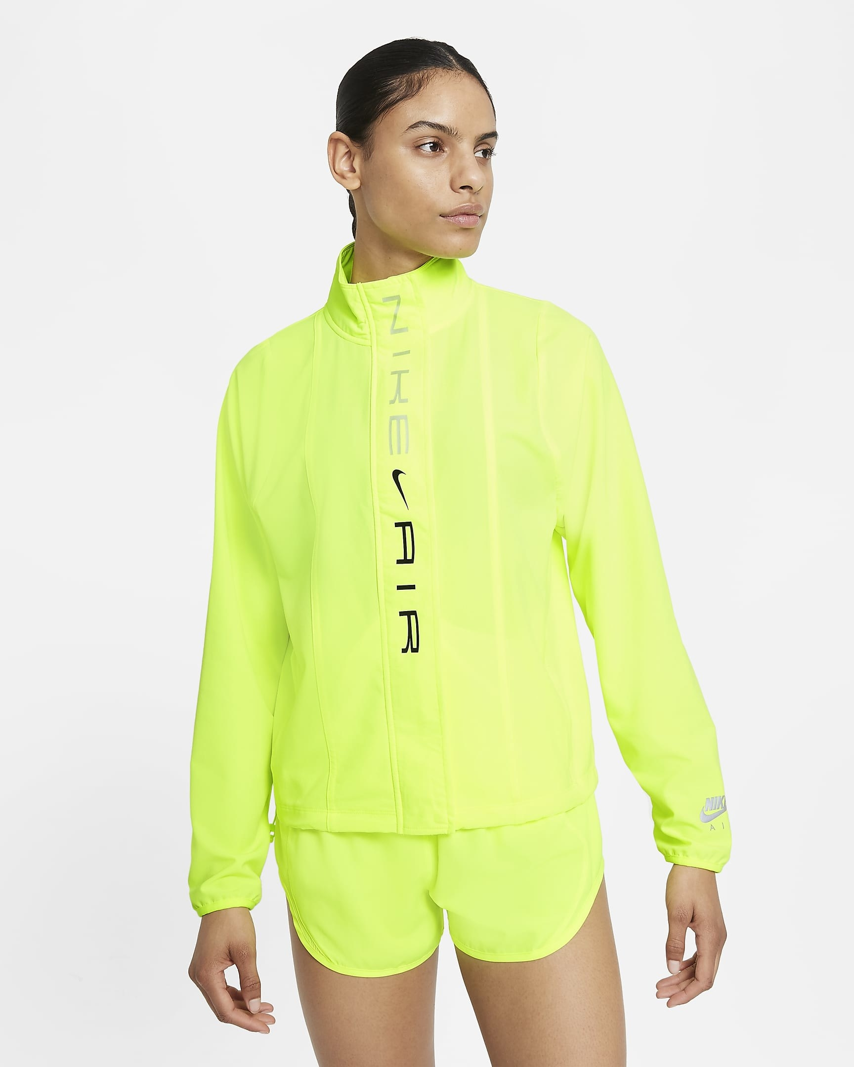 Model wearing neon yellow running jacket with matching shorts
