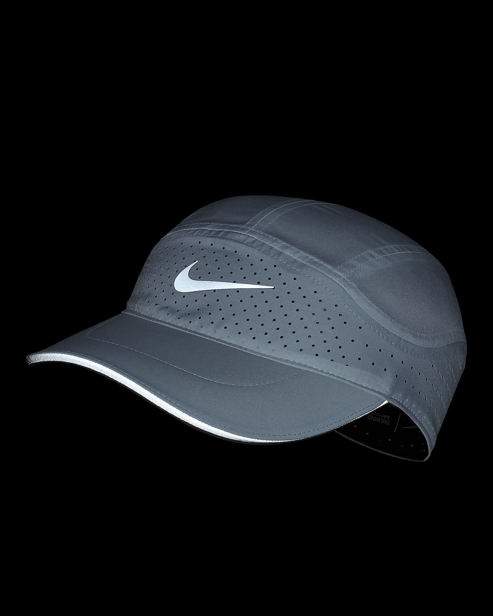 White Nike cap in dark to show reflective detailing