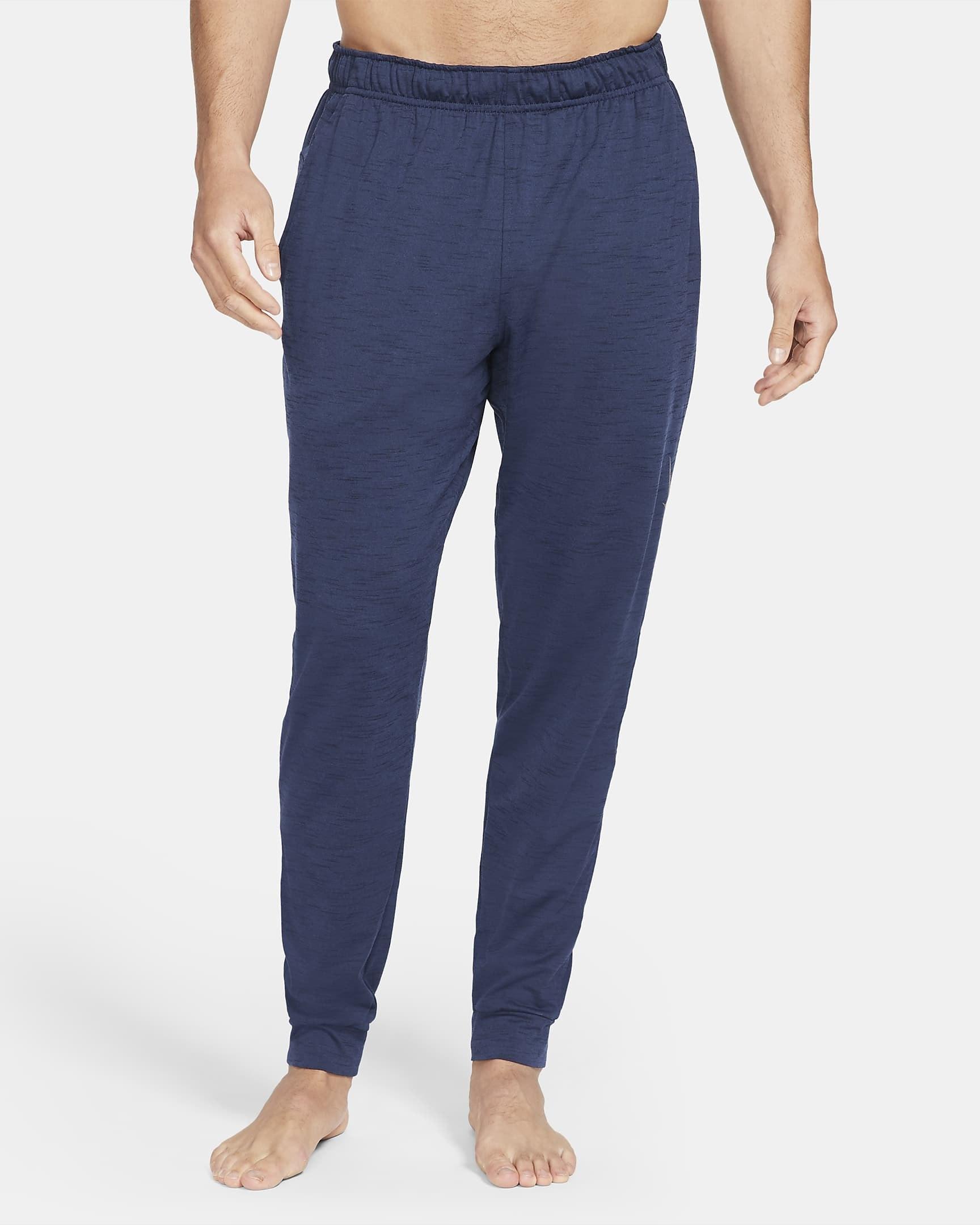 Model wearing navy blue joggers