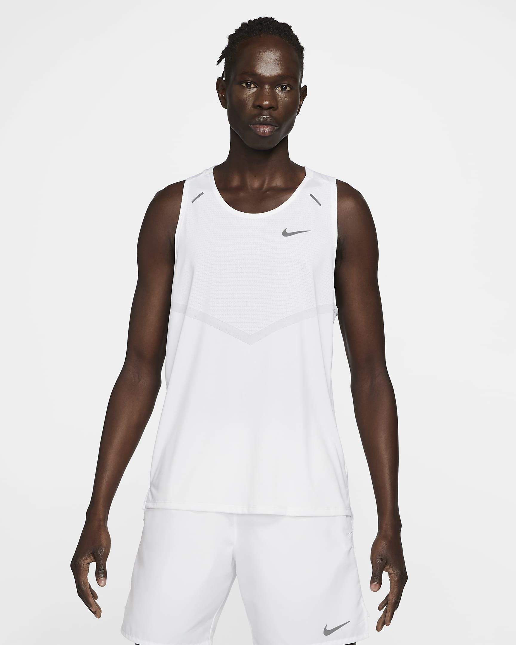 Model wearing white running tank with matching white shorts