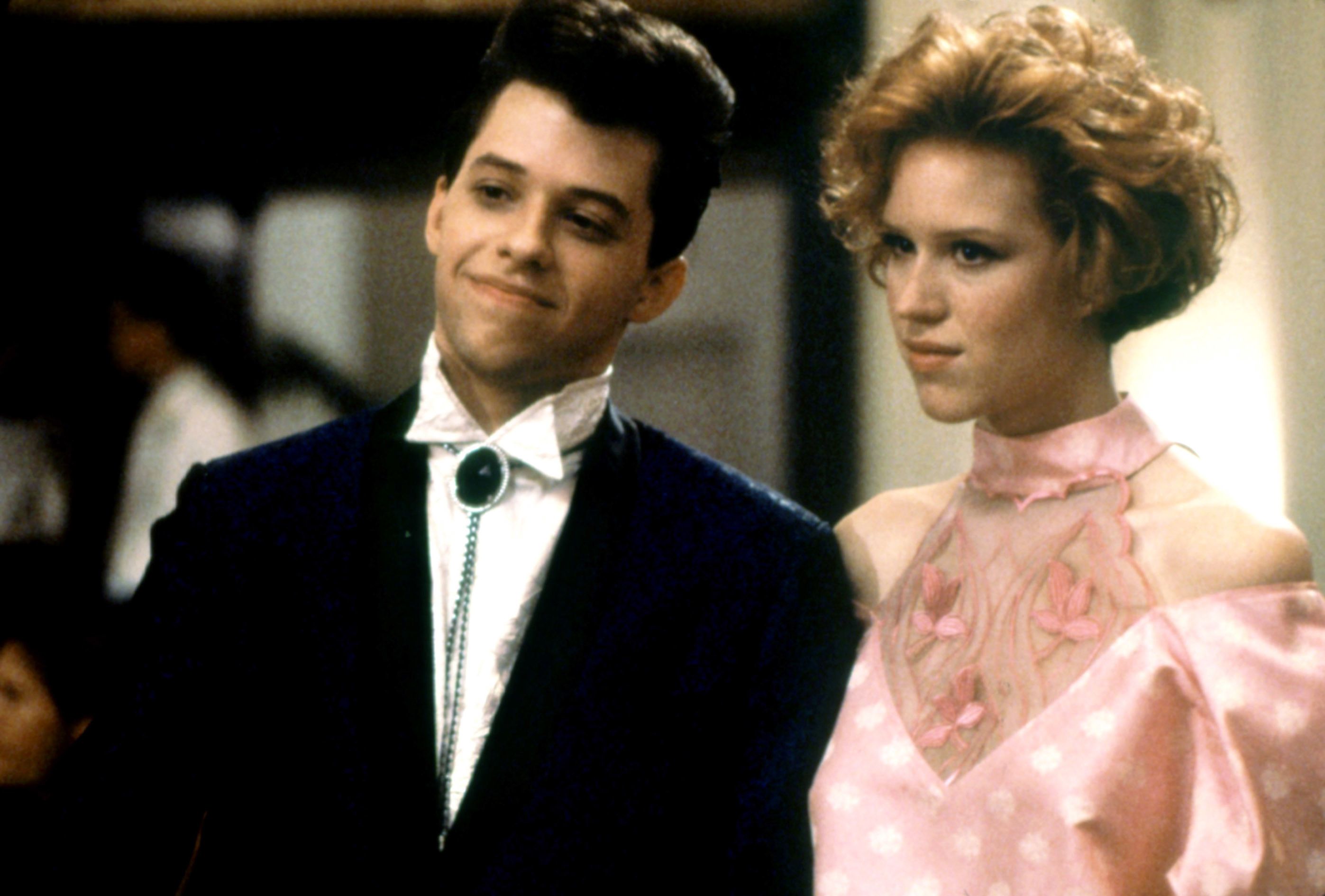 Andie and Duckie standing together at the prom