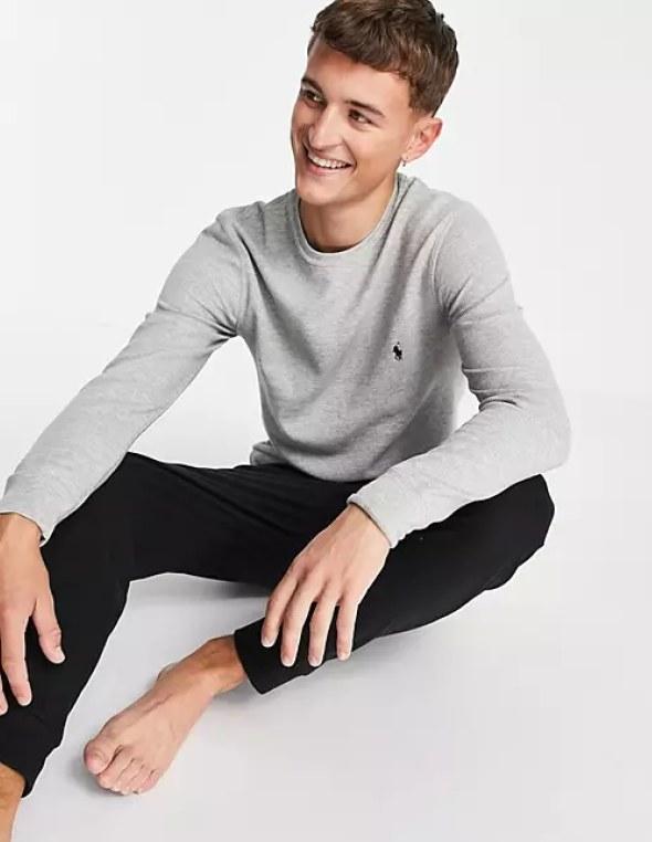 Male model wearing the grey long sleeve shirt