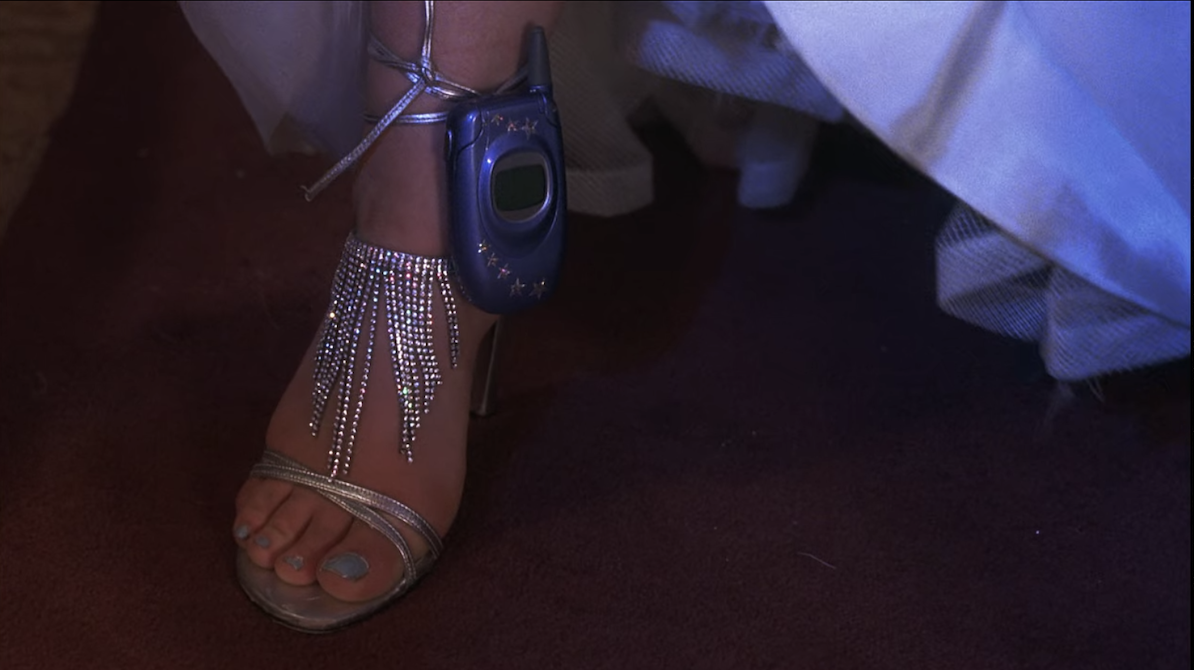 Sam's phone attached to her shoe