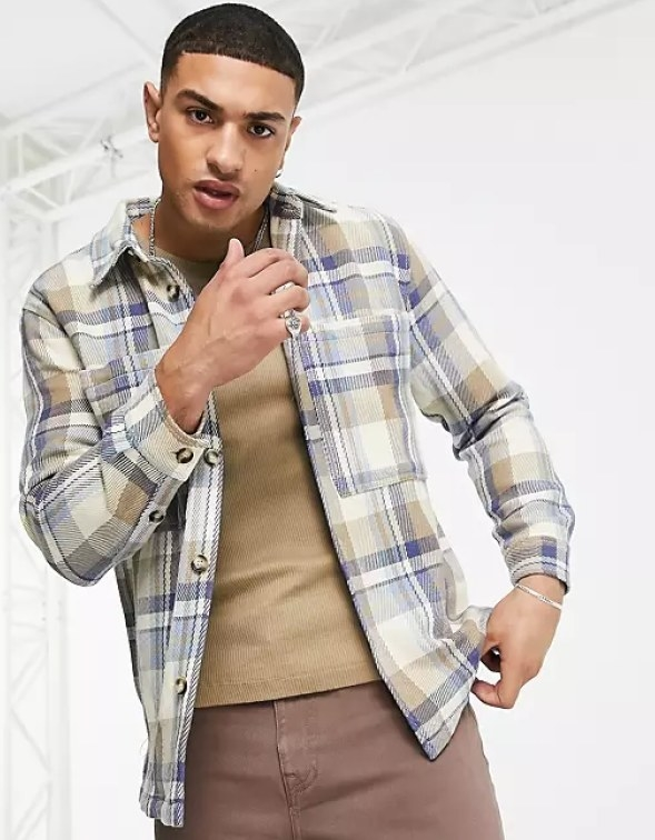 Model wearing the button-down flannel