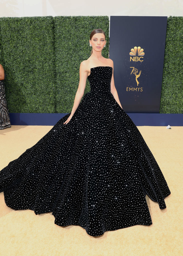 Long ball gown with flared skirt, straight-cut neckline, a tight waist, and jewels that look like stars throughout