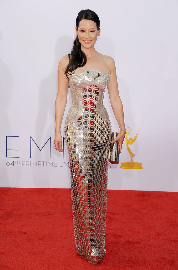 Straight-cut tight, strapless dress with a slight scallop in the neckline and circular sequins throughout