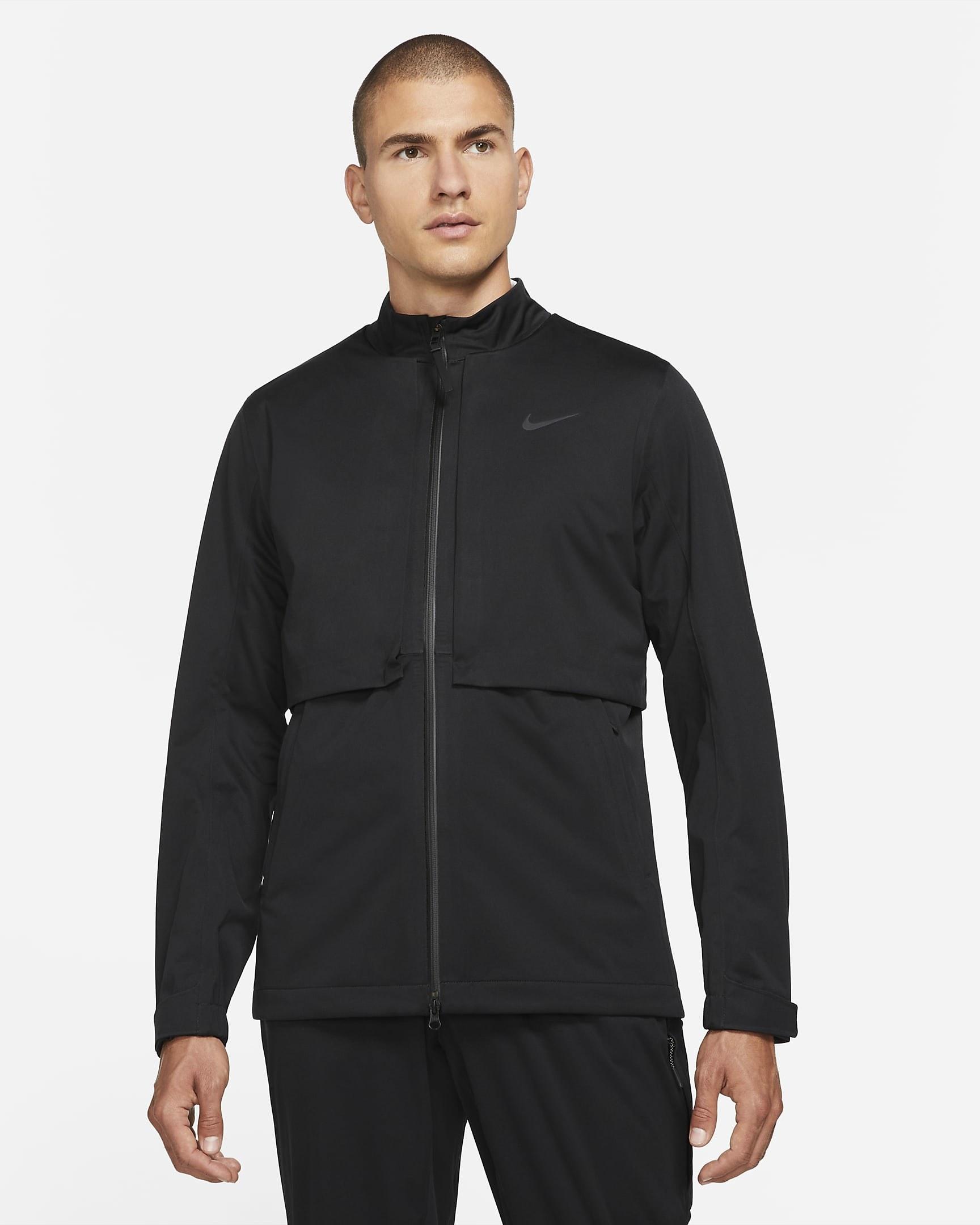 Model wearing black weatherproof jacket zipped up