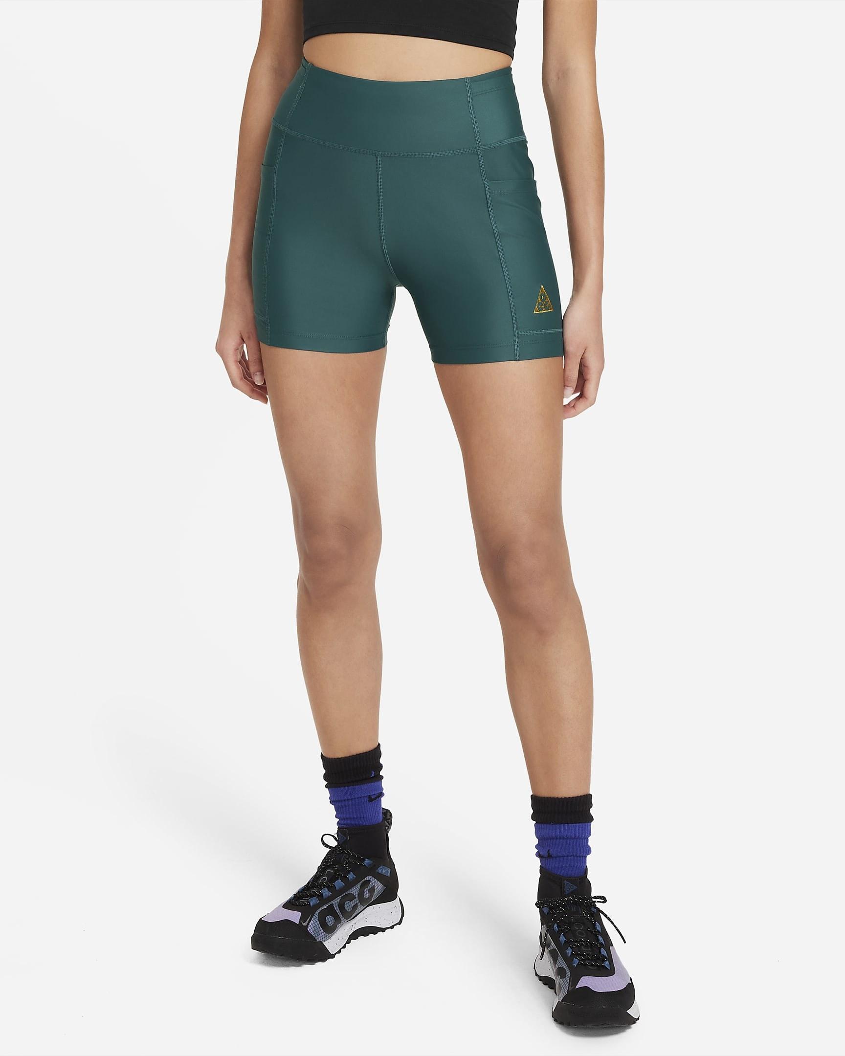 Model wearing deep green biker shorts