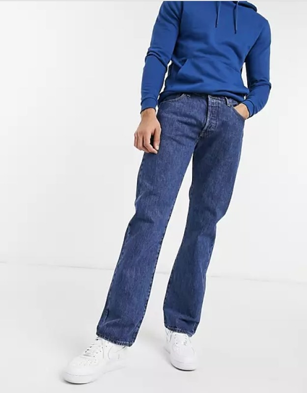 Male model wearing the navy blue wash straight fit jeans