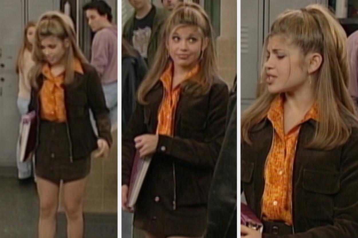 Topanga wearing a matching corduroy jacket and mini skirt with an orange collared blouse
