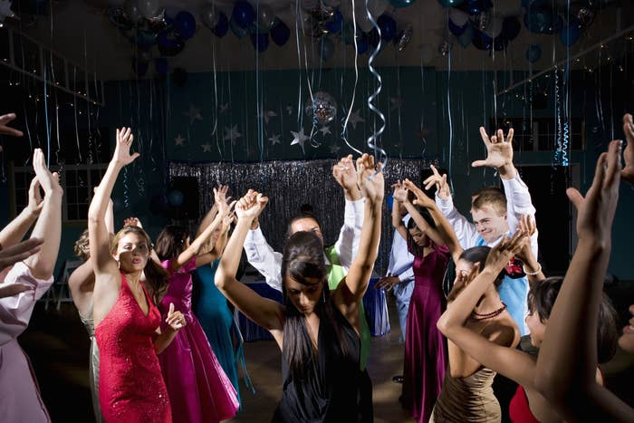 A bunch of teenagers dancing at prom.