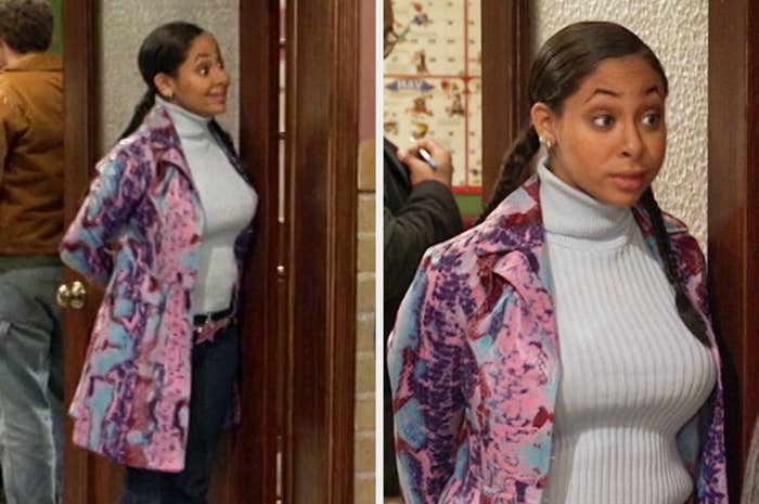 Raven wearing a multicolor faux snakeskin coat and a ribbed turtleneck with jeans