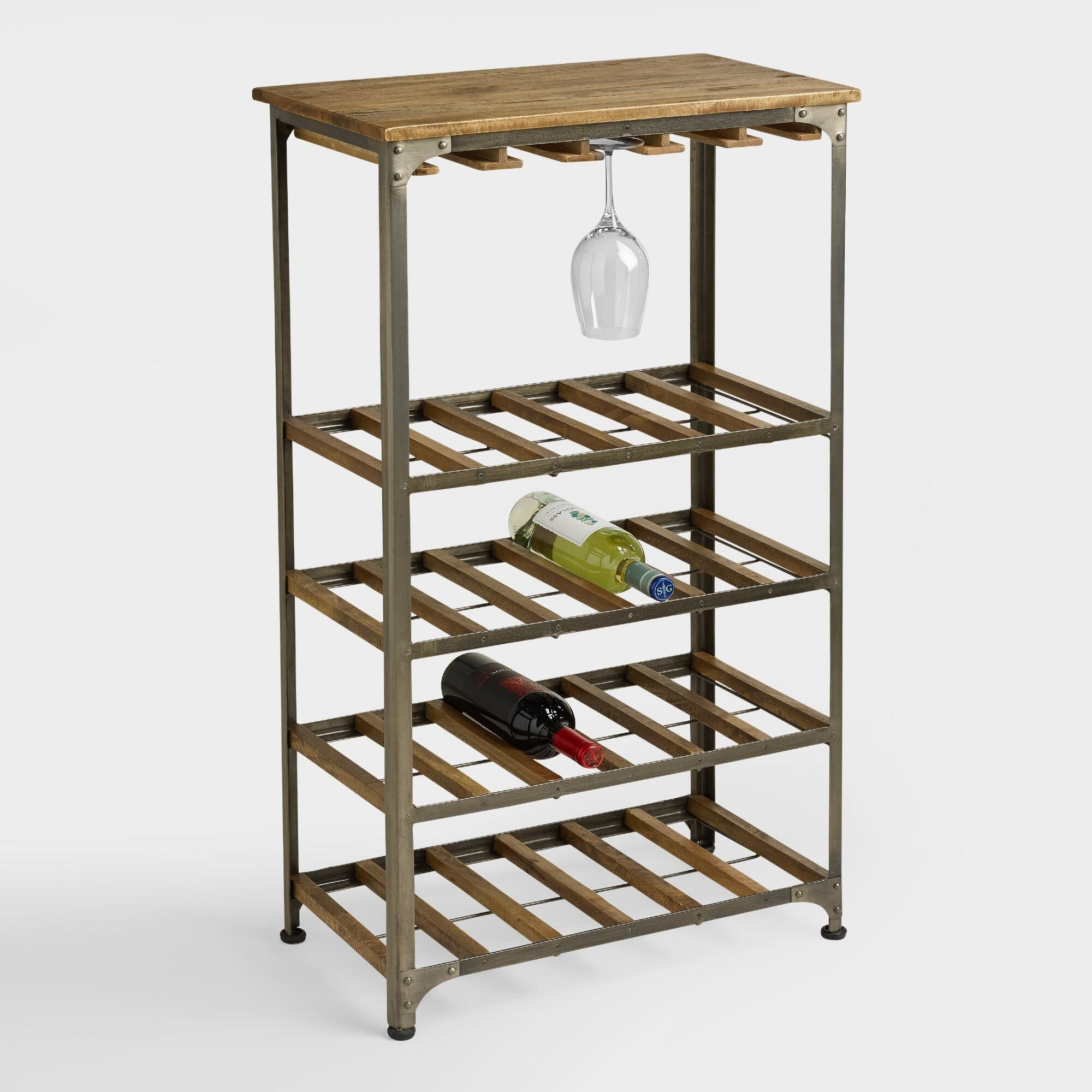 The rack holding wine bottles and a glass