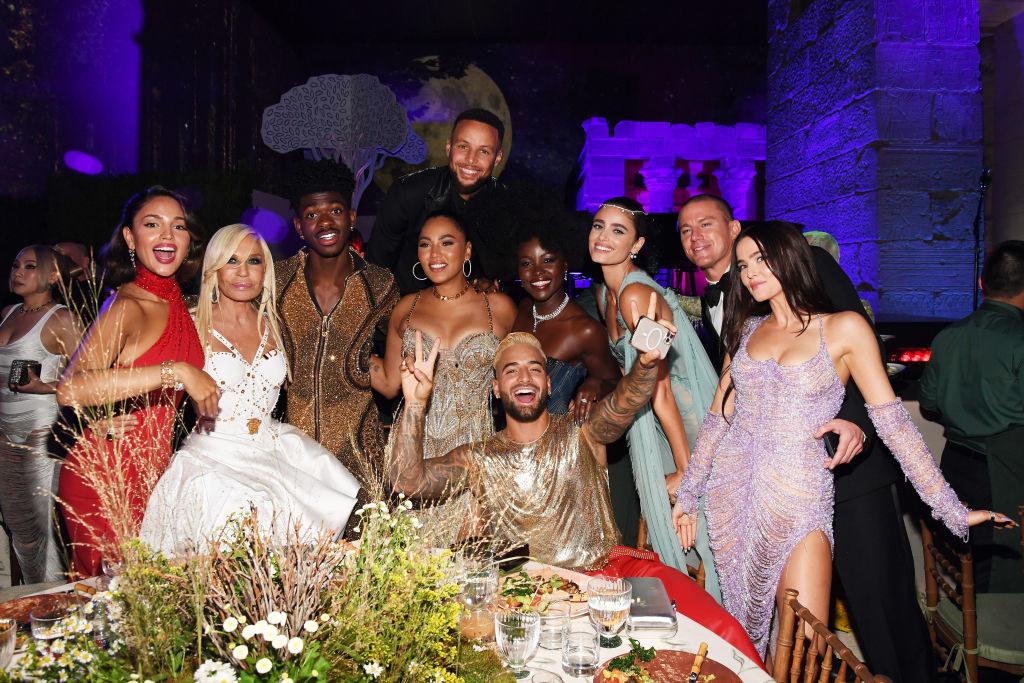 Maluma, Donatella Versace, Lil Nas X, Stephen Curry, Aisha Curry, Lupita Nyong'o, Channing Tatum pose for a photo