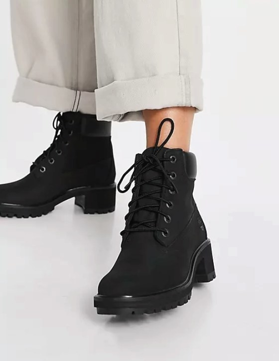 Close up of model wearing the lace up boots