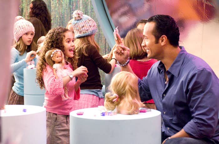 the rock and young madison in an American Girl store