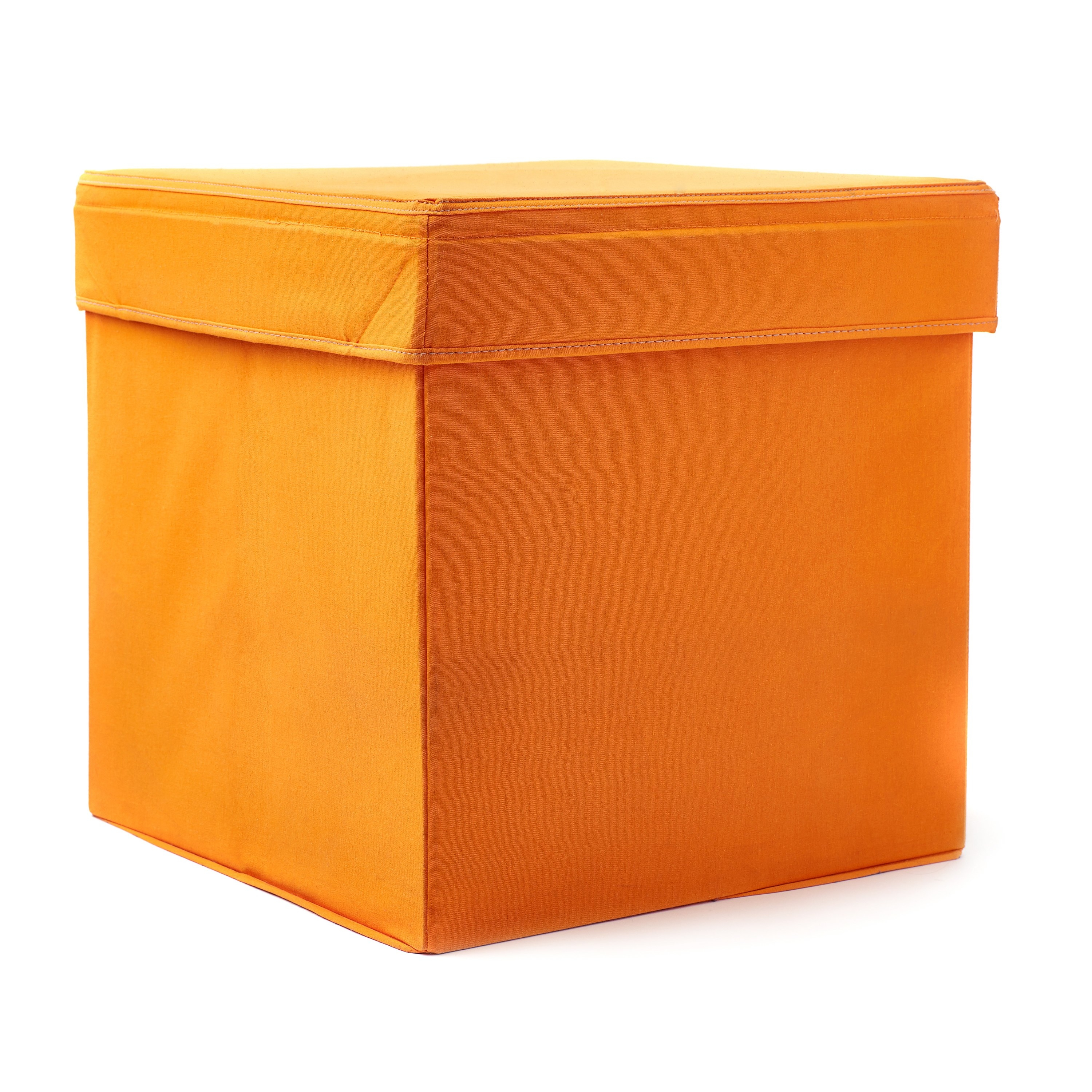 Photo of an orange seating cube against a white backdrop