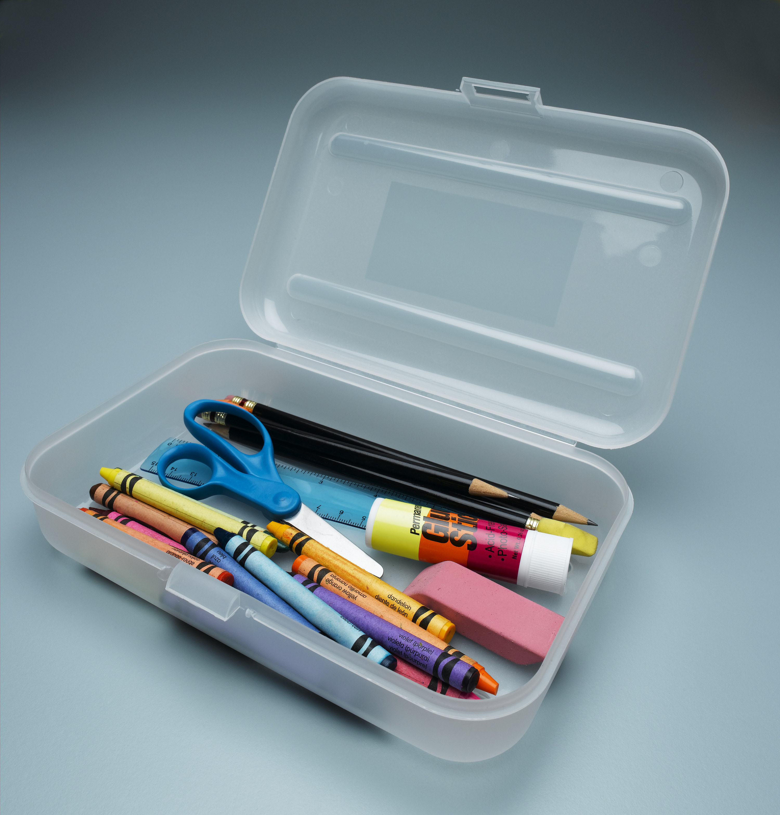 Photo of an open clear pencil box with items stored inside