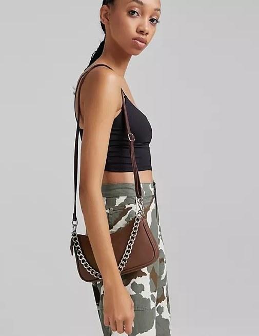 Model wearing the brown bag on her shoulder