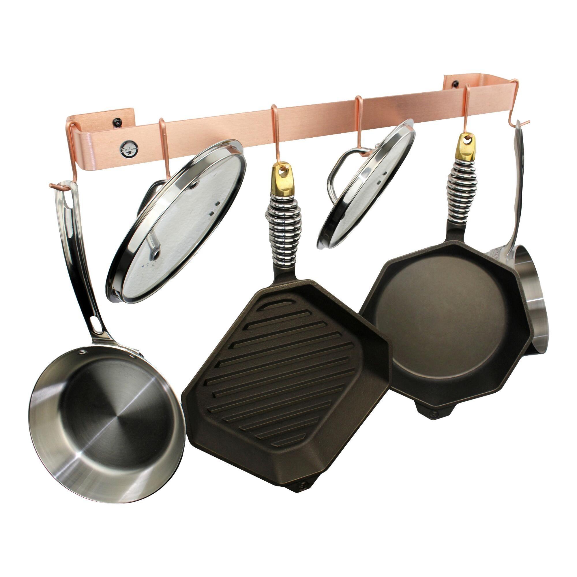 The rack holinng pots, pans, and lids