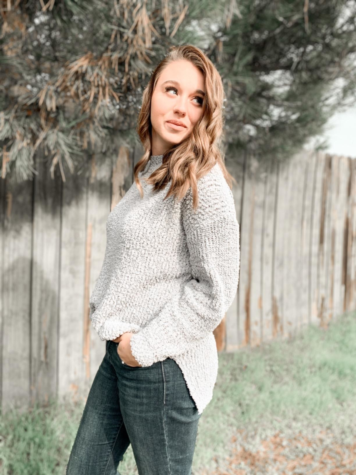a reviewer in the sweater in light gray
