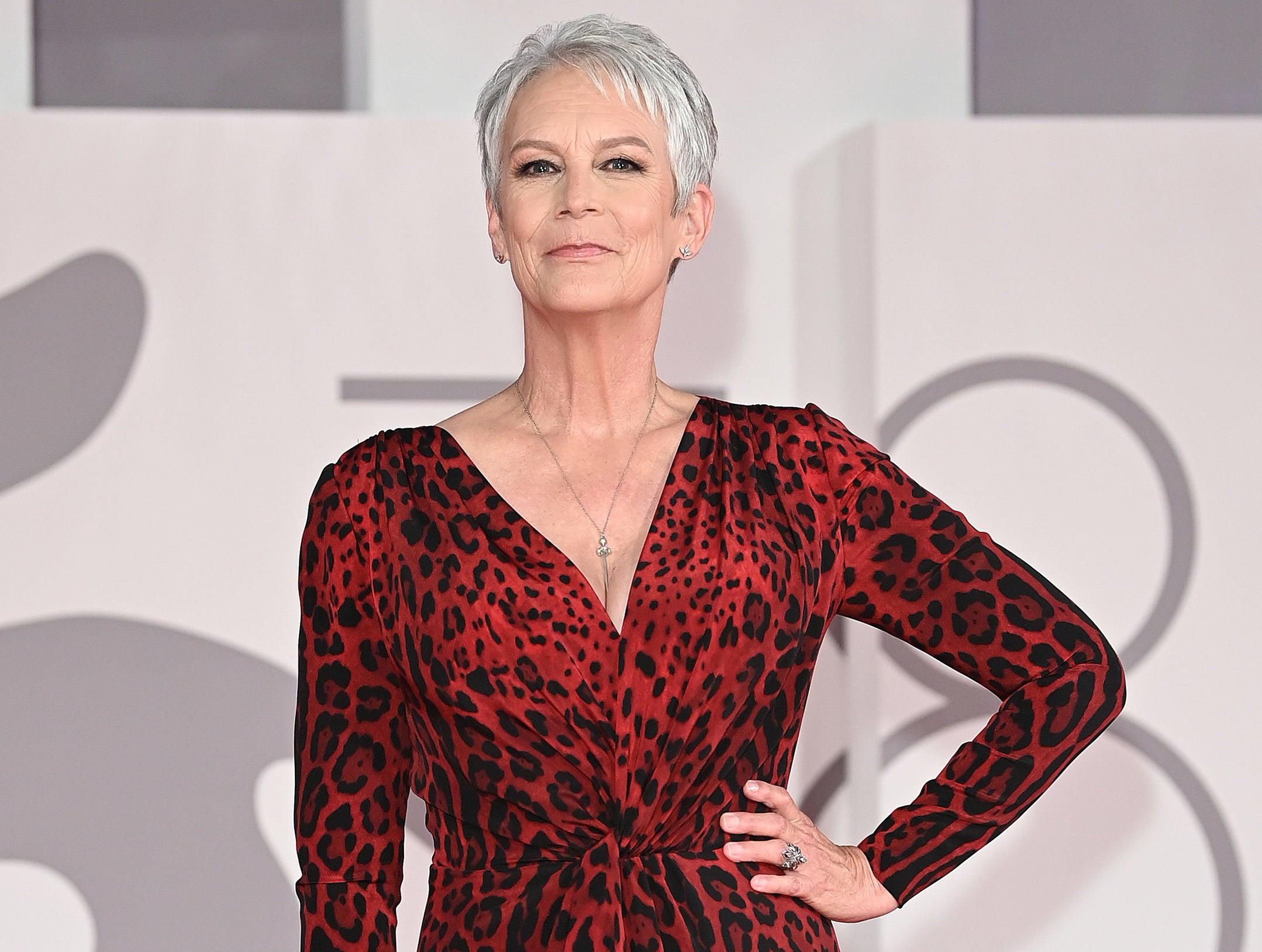 Jamie wears a red leopard print long sleeve dress