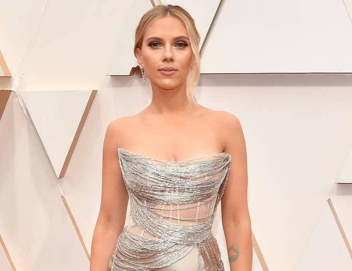 Scarlett wears a metallic strapless dress