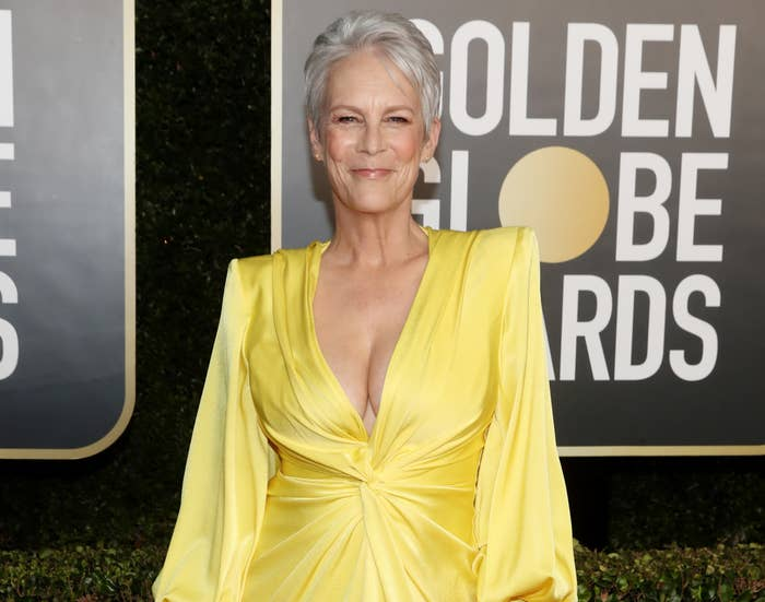 Jamie wears a yellow long sleeve dress with plunging neckline