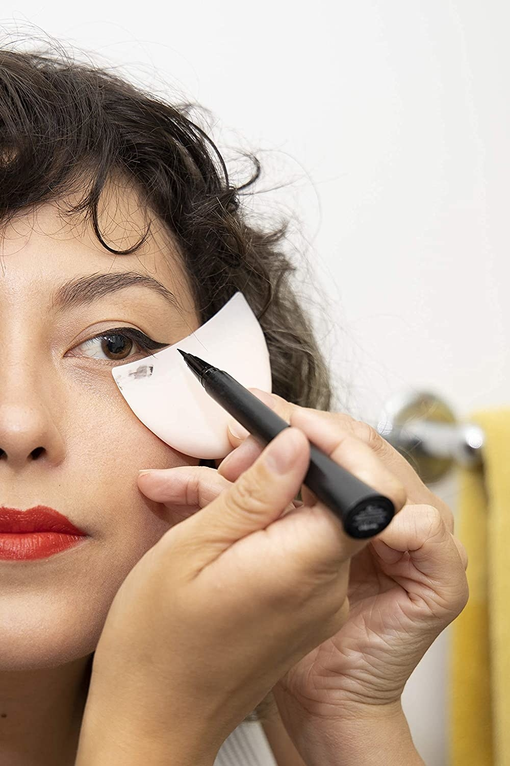 A model using the shield to create winged liner