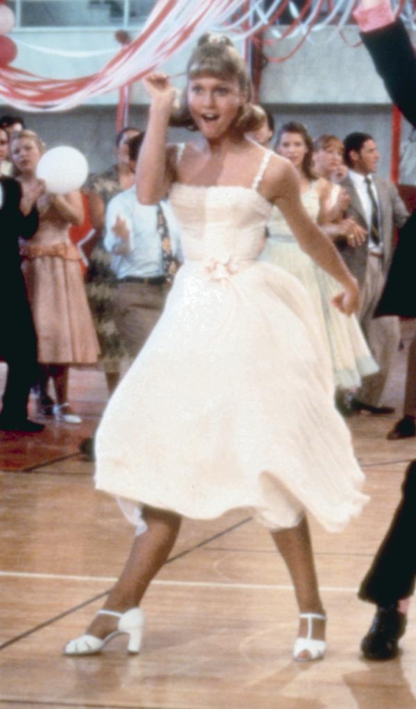 sandy sashay-ing in a white dress