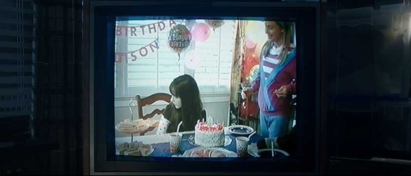 Old VHS tape of girl's birthday party being played on a TV