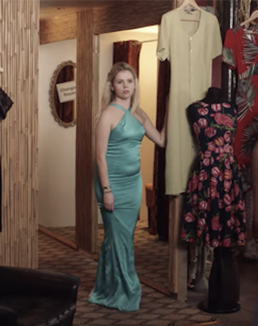 Erin trying on the dress in the dressing room