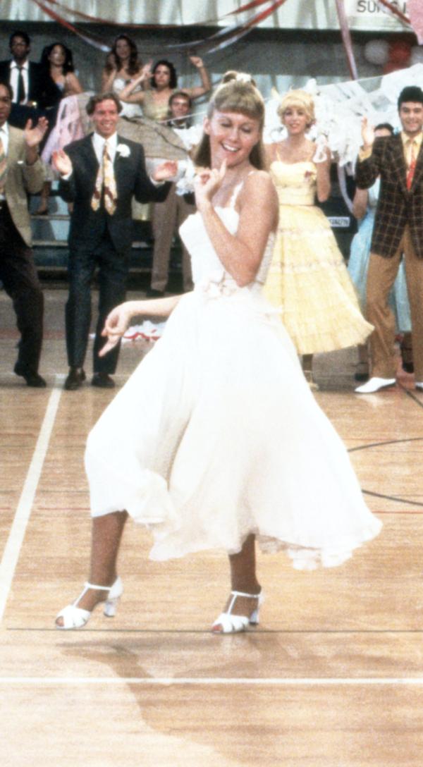 Sandy dancing in her dress