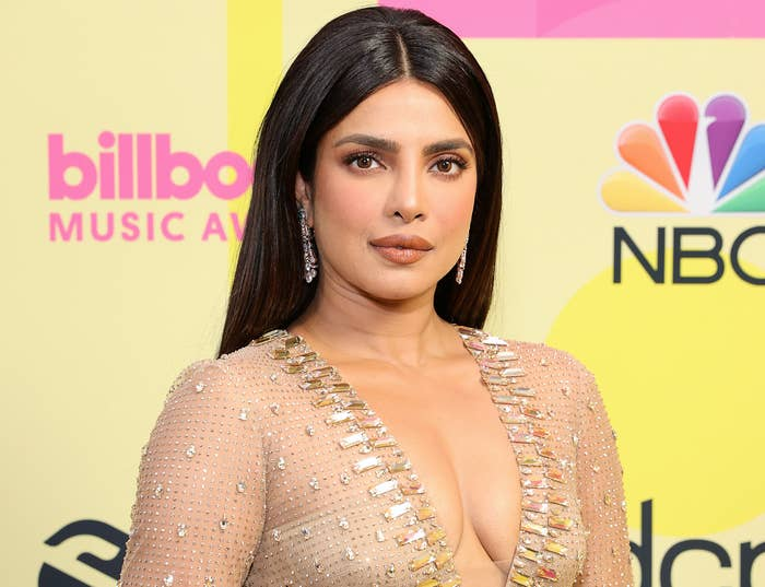 Priyanka wears a sheer jewel encrusted dress with a deep neckline