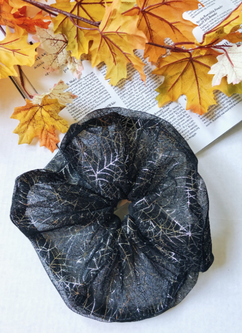 the black organza scrunchie with silver spider webs on it