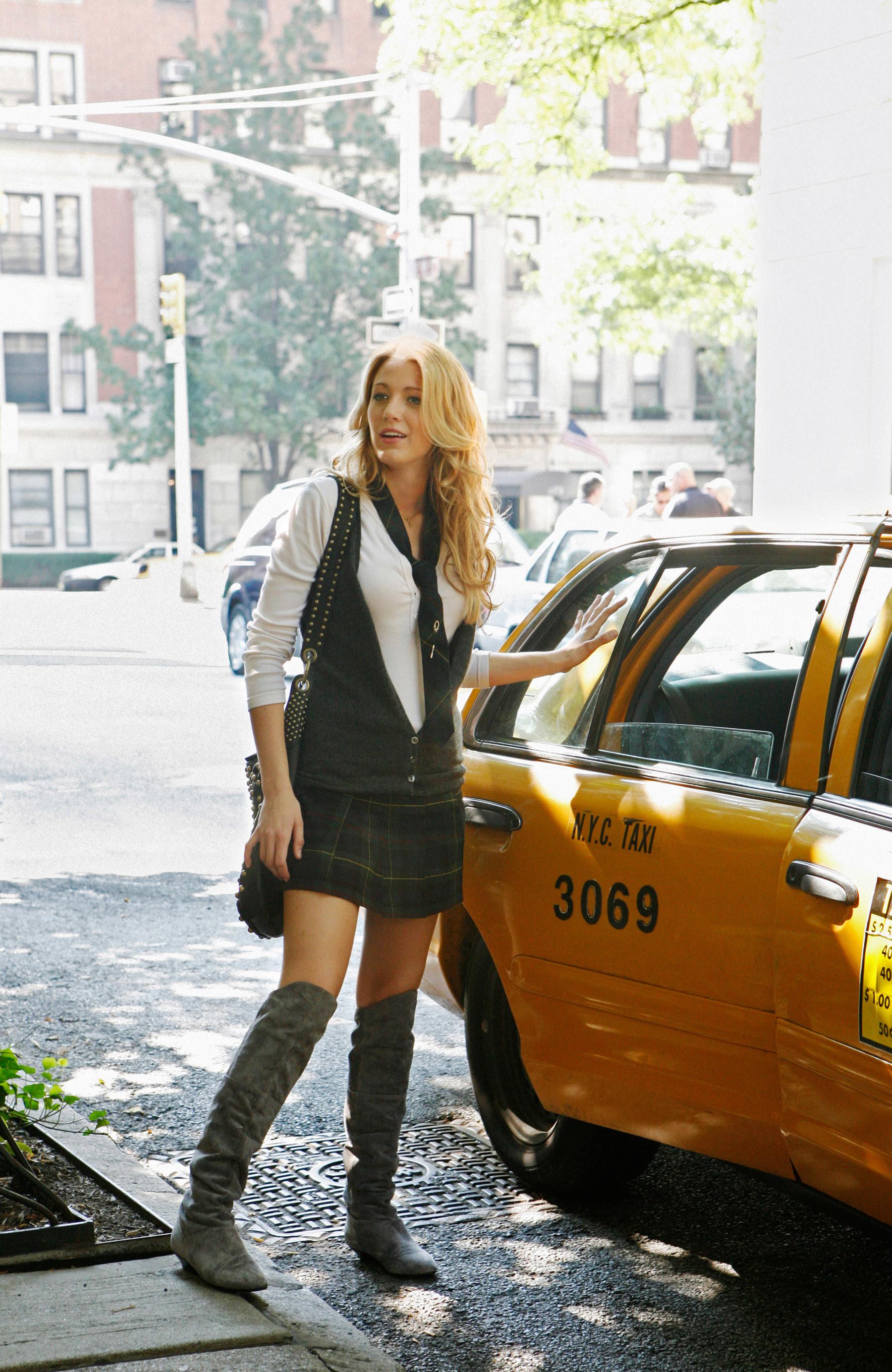 """Serena Van Der Woodsen standing by a cab from the original """"Gossip Girl"""""""