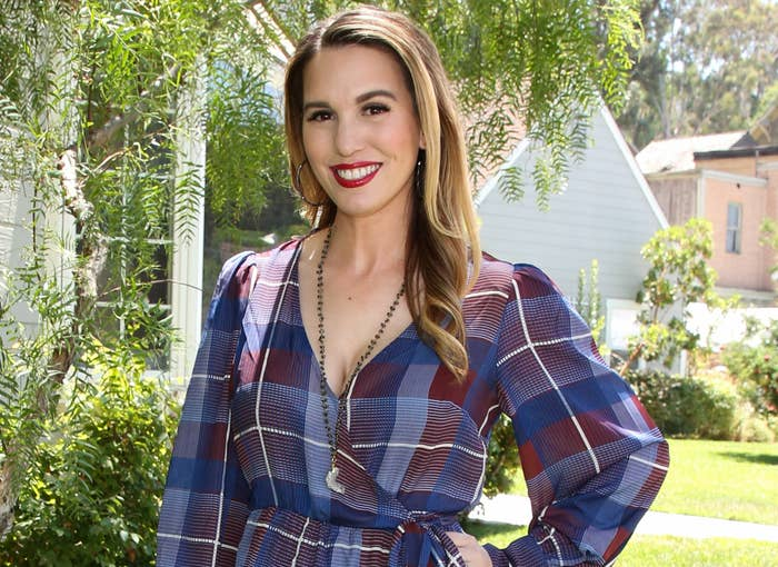 Christy wears a blue and red plaid dress to an event