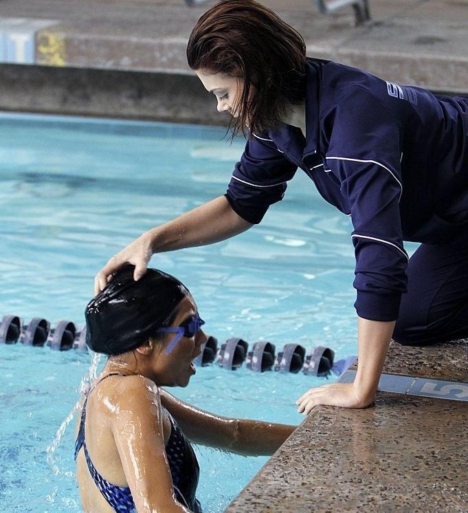 Paige shoves Emily under water