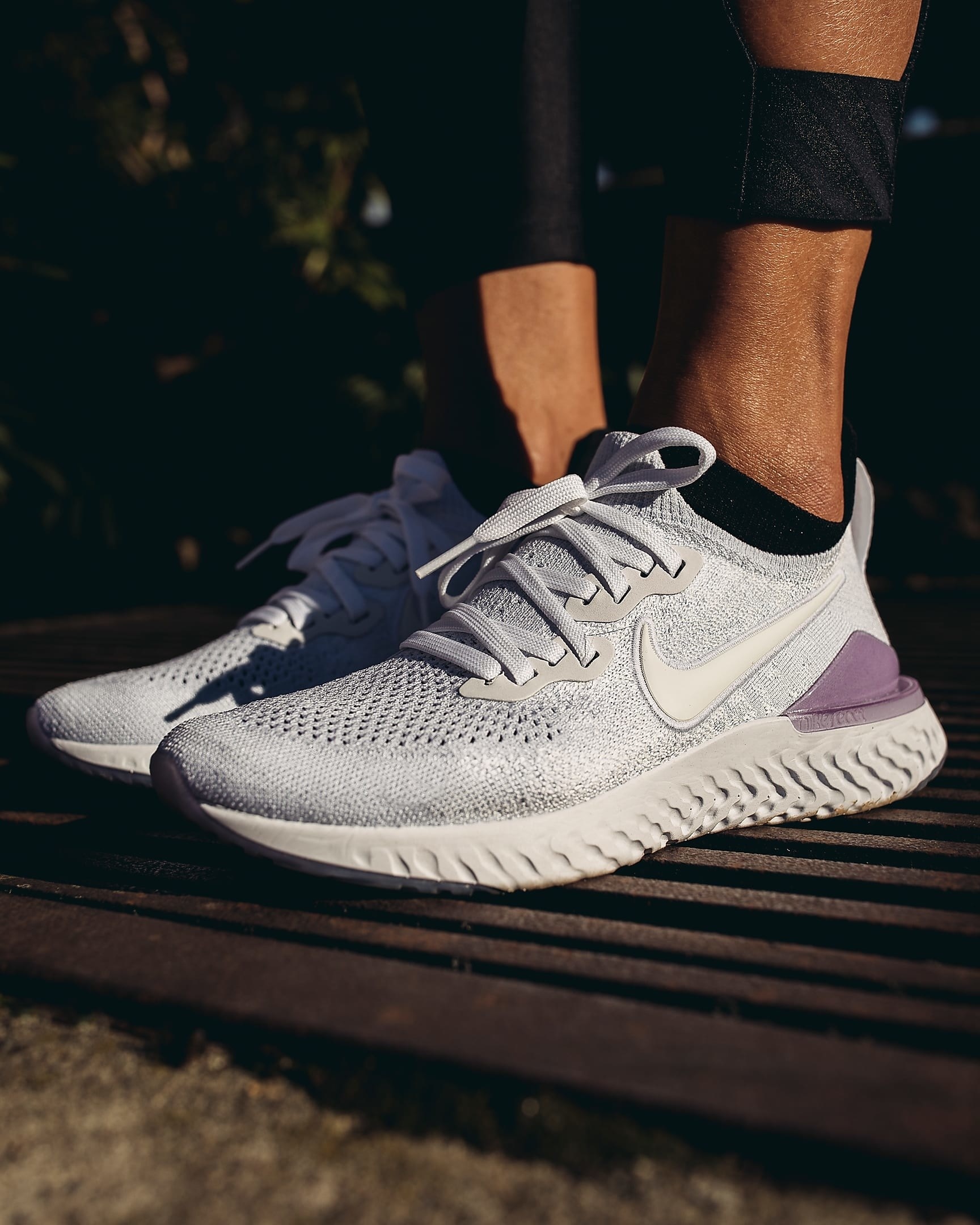 Gray and purple nike flynit sneakers