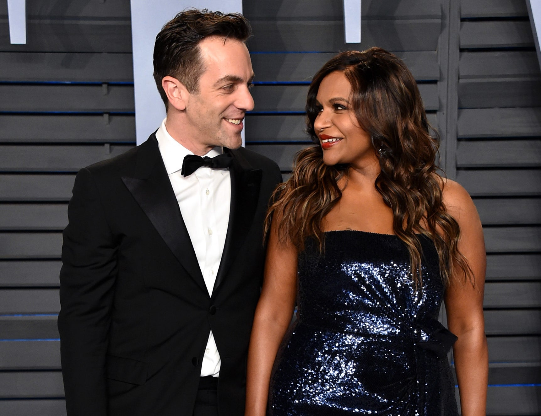 Mindy and B.J. look at each other and smile at an event