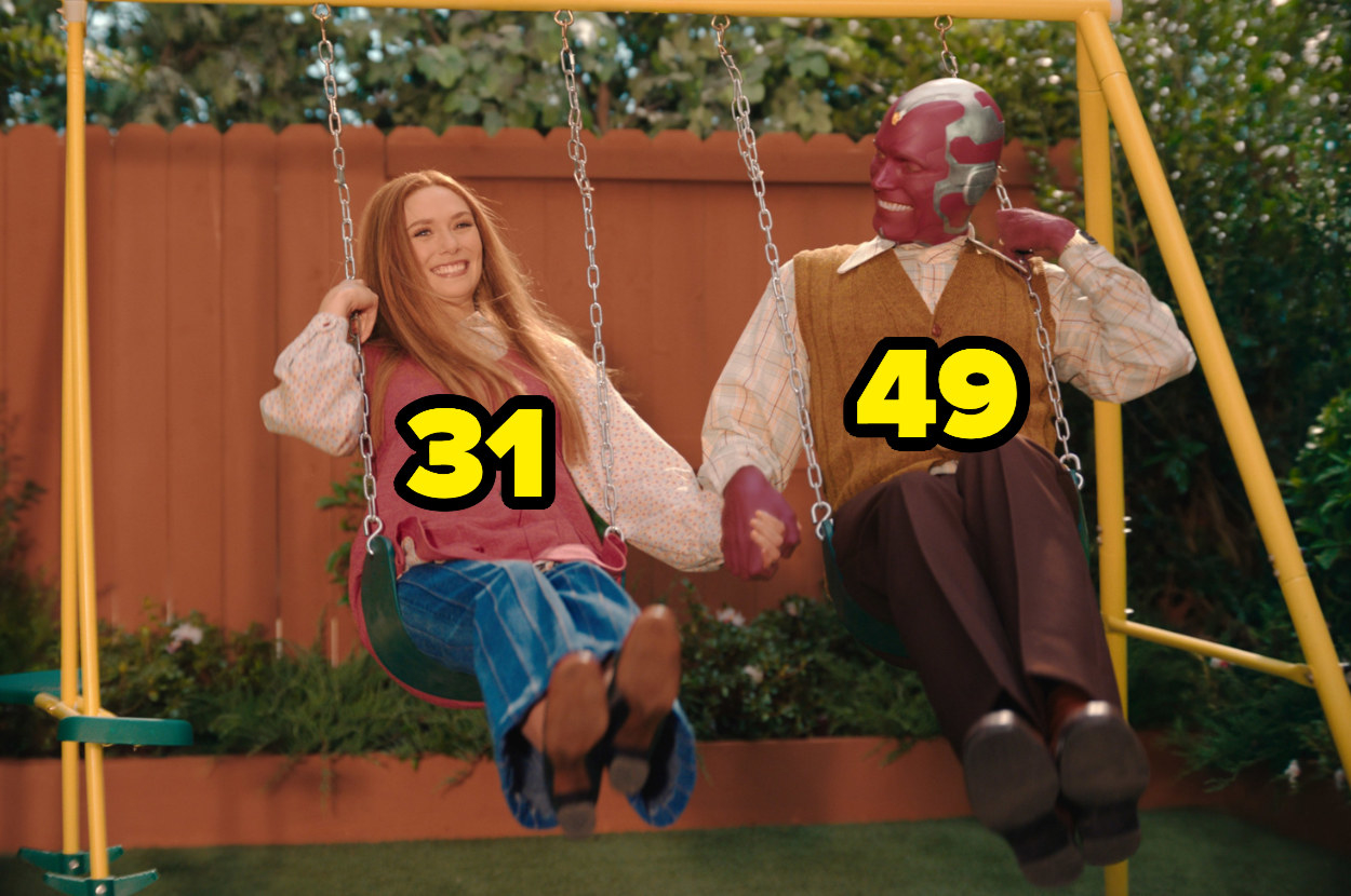 Elizabeth Olsen and Paul Bettany holding hands on a swing set