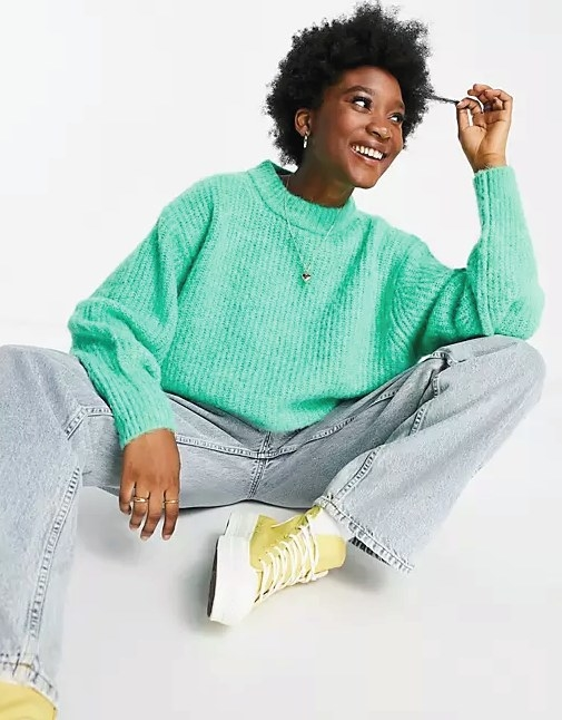 Model wearing the ribbed knit sweater